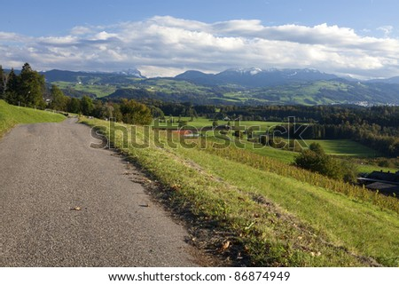 beautiful autumn landscape with a road, hills and mountains