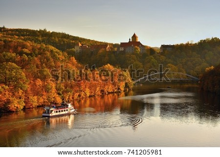 Beautiful Autumn Landscape with Veveri Castle. Natural colorful scenery with sunset. Brno dam-Czech Republic-Europe. Ship at the Brno dam.