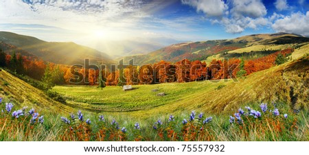 Beautiful autumn mountains landscape and cloudy sky