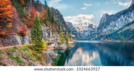 Beautiful autumn panorama of Vorderer ( Gosausee ) lake with Dachstein glacier on background. Splendid morning view of Austrian Alps, Upper Austria, Europe. Orton Effect. #1024663927