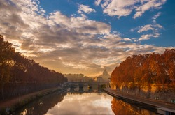 Beautiful autumn sunset colors along River Tiber in the historic center of Rome with evening haze