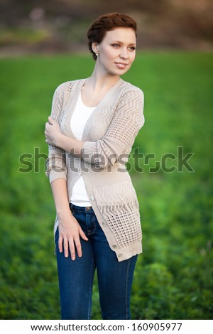 Beautiful autumn woman happy smiling outdoors portrait. Excited happy fall woman smiling joyful in autumn park. Autumn girl in woolen accessories outside.