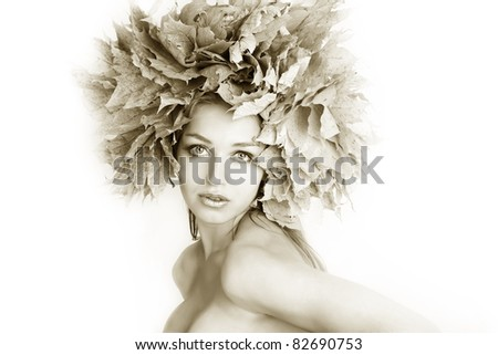 Beautiful autumn women. At the woman an autumn wreath on a head. toned photography.
