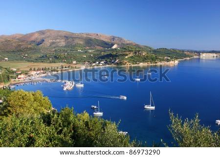 Beautiful azure bay with yachts in Zakynthos, Keri lake village, Greece - stock photo