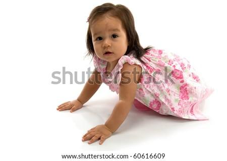 Beautiful Baby crawling on white background .
