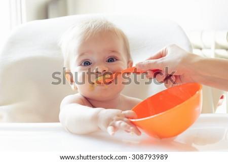 Shutterstock Beautiful baby eating mashed