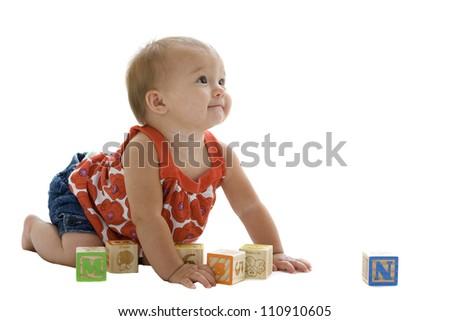 Beautiful baby girl playing with blocks