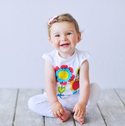 Beautiful baby girl smiling happily