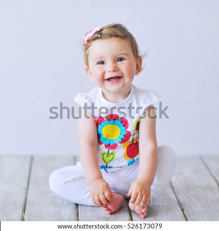 Stock Photo Beautiful baby girl smiling happily