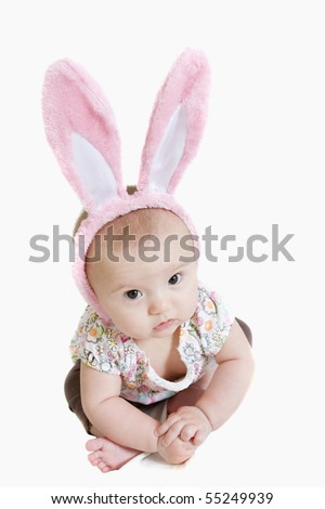 Beautiful baby girl wearing pink bunny ears