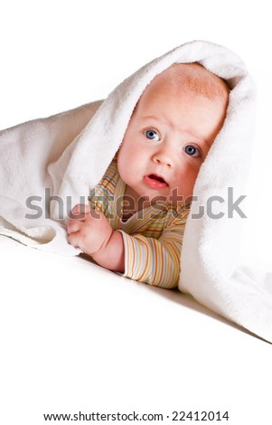Beautiful baby hiding under a white towel