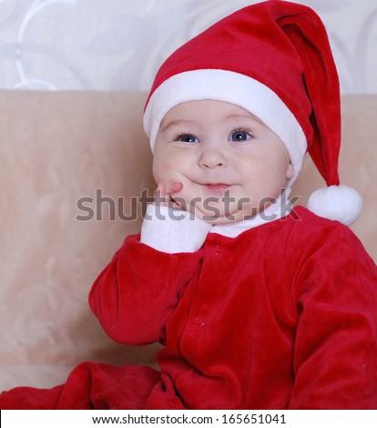 96d592344f1 Beautiful baby in a cap Santa Claus