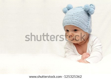 Beautiful baby in blue knitted hat