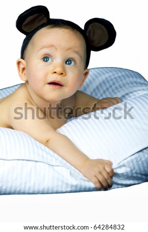 Beautiful baby on pillow  isolated on white