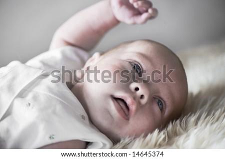 beautiful baby on sheep skin
