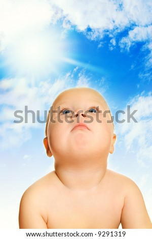 Beautiful baby over blue cloudy sky - stock photo