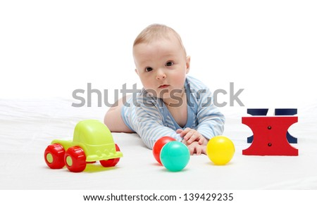 Beautiful baby playing with toys on white
