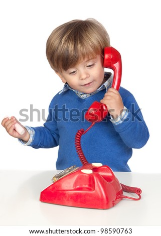 Beautiful baby with a red phone isolated on white background