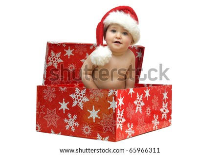 Beautiful baby with Christmas hat isolated in a gift box