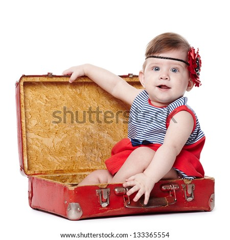 beautiful baby with suitcase isolated on white - stock photo