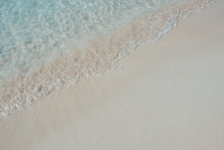 Beautiful background beach in summer. Royalty high-quality free stock image of sea water on the beach with sand and sunshine in summer