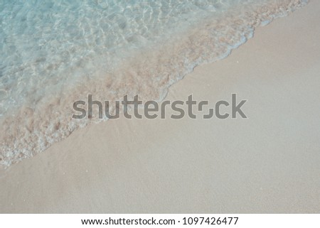 Photo of Beautiful background beach in summer. Royalty high-quality free stock image of sea water on the beach with sand and sunshine in summer