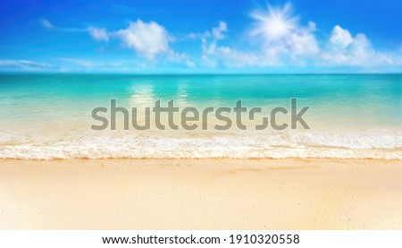 Beautiful background image of tropical beach. Bright summer sun over ocean. Blue sky with light clouds, turquoise ocean with surf and clear sand. Harmony of clean environment. Wide format.