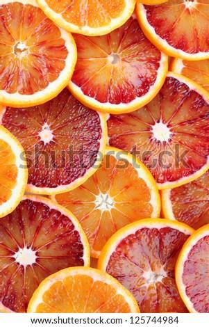 Beautiful background made of blood orange slices - stock photo