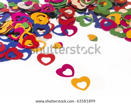 beautiful background of shiny confetti in the shape of hearts in different colors