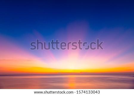 Beautiful background sunrise or sunrise sky with sunbeam over the sea. Copy space
