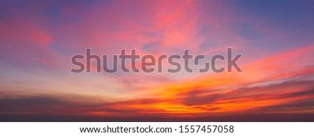 Beautiful background sunrise or sunrise sky with sunbeam over the sea. Copy space and banner composition.