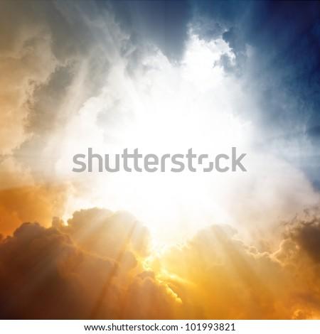 Beautiful background - sunset sky, bright sun shines through clouds