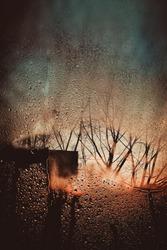 beautiful background with rain drops. drops on glass in rainy day. rain outside window on rainy autumn day.  texture of raindrops, wet glass. autumn rainy season
