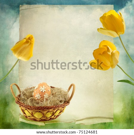 beautiful background with yellow tulips and easteregg