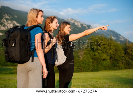 Beautiful backpackers - Three beautiful girls on a trip with backpacks