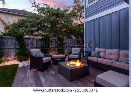Beautiful backyard firepit at dusk with comfortable chairs