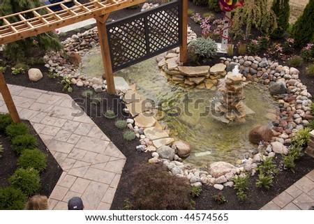 Beautiful backyard fountain and pool