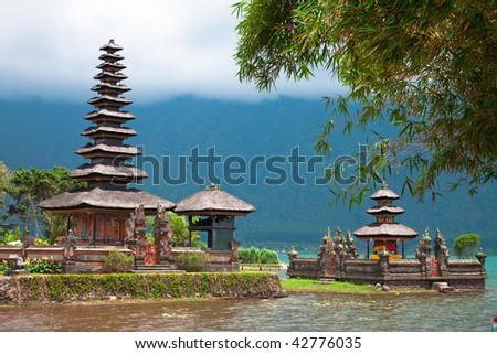 Beautiful Balinese Ulun Danau temple on lake Beratan in extinct volcano crater in Bali, Indonesia