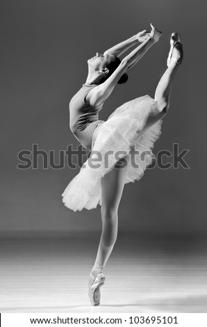 beautiful ballerina in white tutu doing acrobatics