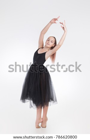 ee02f14ab42e Beautiful ballerina wearing black transparent dress. Posing looking ...