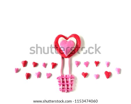 Beautiful balloon and red pink heart made from plasticine clay on white background, lovely pattern dough #1153474060