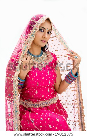 Beautiful Bangali bride in colorful dress and veil, isolated