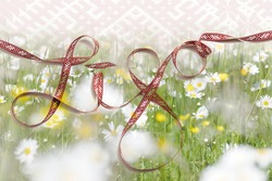Beautiful banner for traditional latvian midsummer celebration called Ligo. Greeting card with Lielvarde belt, daisy meadow and word ligo on background. Place for text.