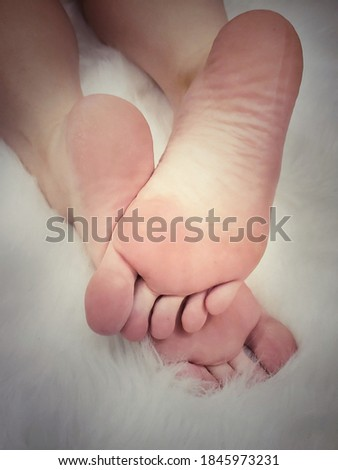 Beautiful bare feet with long toes