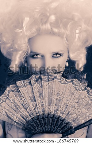 Beautiful Baroque Woman Monochrome Portrait with Wig and Fan - Baroque style portrait of a young beautiful woman behind a hand fan