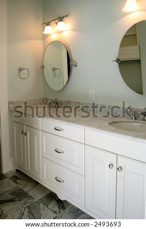 beautiful bathroom with carerra marble floors and granite counter
