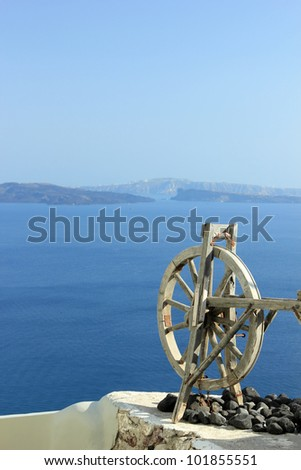 beautiful bay of Oia with clear blue sky and sea - Santorini, Greece - stock photo