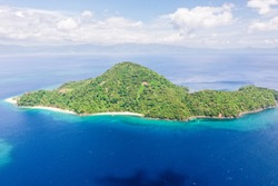 Beautiful bay with a tropical island. Atulayan Island, Camarines Sur, Philippines. Seascape, view from above. Summer and travel vacation concept.