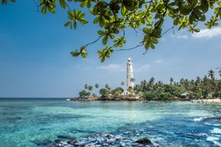 Beautiful beach and light house in Sri Lanka