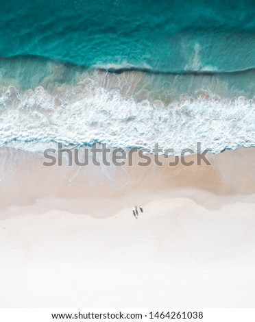 Beautiful beach and water at sunrise with people standing in front of wave and on white sand on the Gold Coast. Queensland New South Wales Brisbane Byron Bay Sunshine Coast Noosa Bondi Manly #1464261038